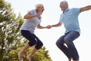 older-couple-jumping-600x400